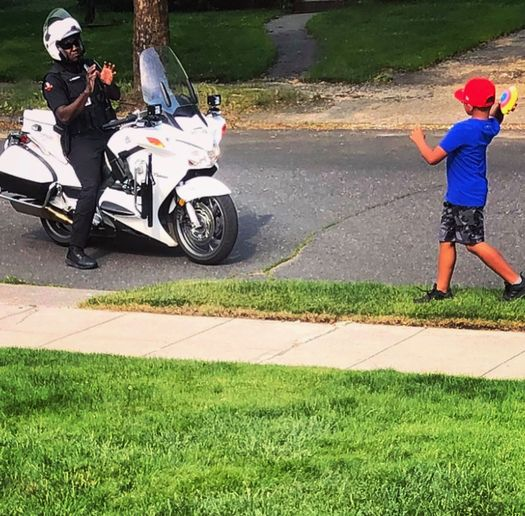 A motor officer with the Spokane (WA) Police Department was seen over the weekend playing a little game of catch with a young man, and the image posted to social media quickly drew dozens of comments of appreciation from local citizens.