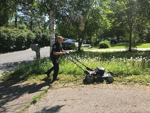 An officer with the Orono (MN) Police Department was called to do a welfare check on an elderly woman's home late last week, and having completed that objective decided to also attend to her overgrown lawn.