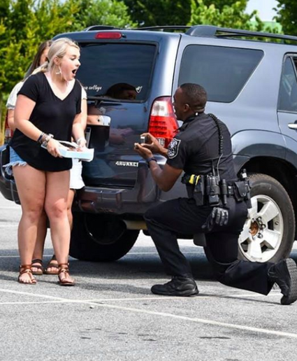 Officer John Heart made plans with his LPD friends to propose to his girlfriend during a traffic stop.  - Image courtesy of Gwinnett County Sheriff's Office.