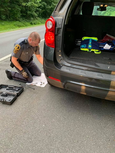 An officer with the Virginia State Police received some gratitude from a stranded motorist after he changed the left rear tire of her minivan.
