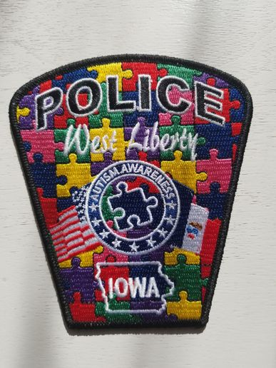Earlier this year, the West Liberty Police Department designed and sold special police patches with the puzzle pattern that represents Autism awareness. That effort raised $3,000.