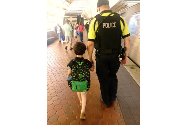 A woman posted a lengthy thank you note on Facebook, expressing her gratitude for the actions of a DC Metro police officer who help calm her young autistic son who was having an episode on a commuter train.  - Photo: Taylor Pomilla/Facebok