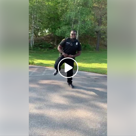 "Officer Eze VanBuckley participating in the ""Get Up Challenge,"" which involves a specific choreography of dance moves set to a song by Blanco Brown.