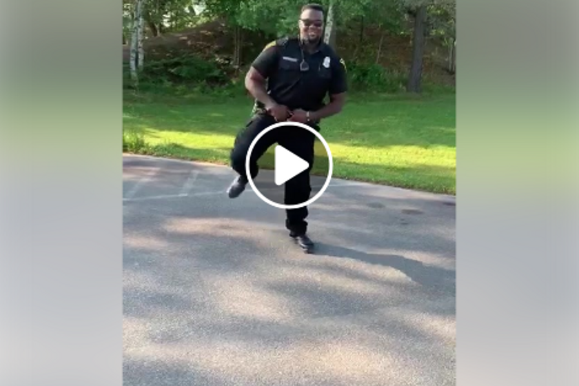 """Officer Eze VanBuckley participating in the """"Get Up Challenge,"""" which involves a specific..."""