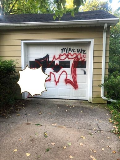 An officer with the Baraboo (WI) Police Department took it upon himself to help a 73-year-old man cover over graffiti painted across a garage door on Wednesday.