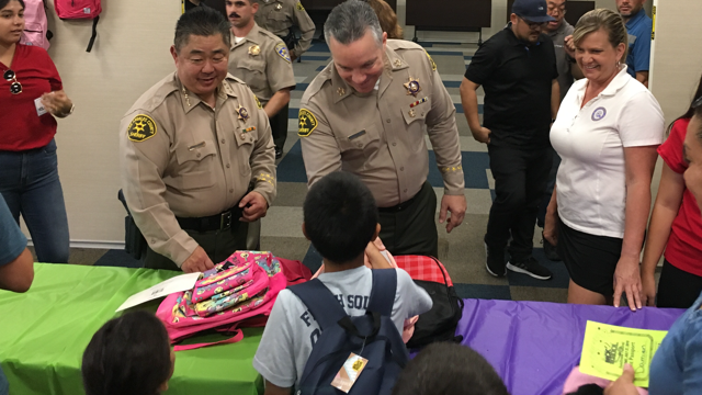 Deputies with the Los Angeles County Sheriff's Department over the weekend held an event to provide school supplies to underprivileged children in the region.  - Image courtesy ofLos Angeles County Sheriff's Department / Facebook.