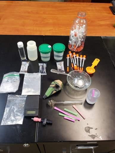 Officers with the Loretto (TN) Police Department had some fun on Facebook when they posted an image of drugs and drug paraphernalia seized from a man who was attempting to flush the stuff down a toilet.