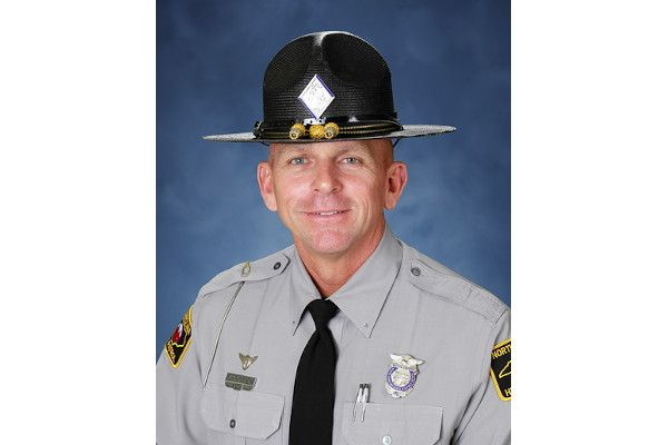 Trooper Chris Wooten was on his motorcycle in pursuit of a vehicle when another car crashed into him in an intersection in Charlotte, NC, earlier in July.  - Photo: North Carolina State Highway Patrol