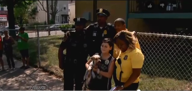 Police officers with the Newark Police Department have donated a new service dog to a 10-year-old boy with Autism after learning that his previous dog had died when it was struck by a car.  - Image courtesy of New Jersey News 12.