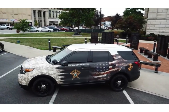 The Clinton County Sheriff's Office recently unveiled a patrol vehicle specially wrapped with a tribute to the military service of one of its deputies.  - Image courtesy of Clinton County Sheriff's Office / Facebook.