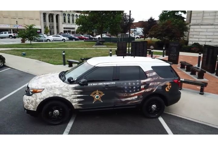 The Clinton County Sheriff's Office recently unveiled a patrol vehicle specially wrapped with a tribute to the military service of one of its deputies.
