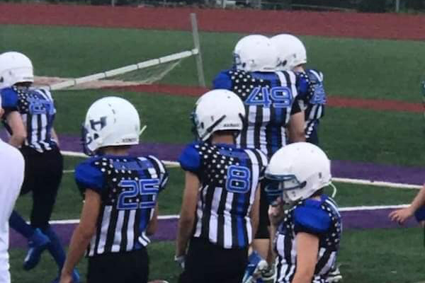 The Harrisonville (MO) Police Department is celebrating the decision made by its local little league football team to wear uniforms representing their respect for law enforcement.  - Image courtesy ofHarrisonville (MO) Police Department / Facebook.