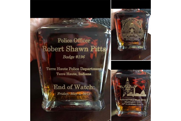 The Jack Daniels Distillery presented a specially engraved bottle of its whiskey to the family of Officer Robert Pitts of the Terre Haute (IN) Police Department  - Photo: Greg Pitts/Facebook