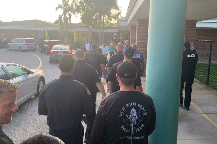 Officers with the West Palm Beach (FL) Police Department took time on Monday to escort the son of a colleague who succumbed to cancer last year to his first day of Kindergarten.