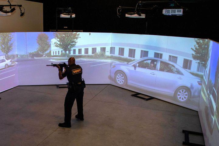 An officer trains using a FATS 300 multi-screen immersive simulator.  - Photo: Meggitt Training Systems
