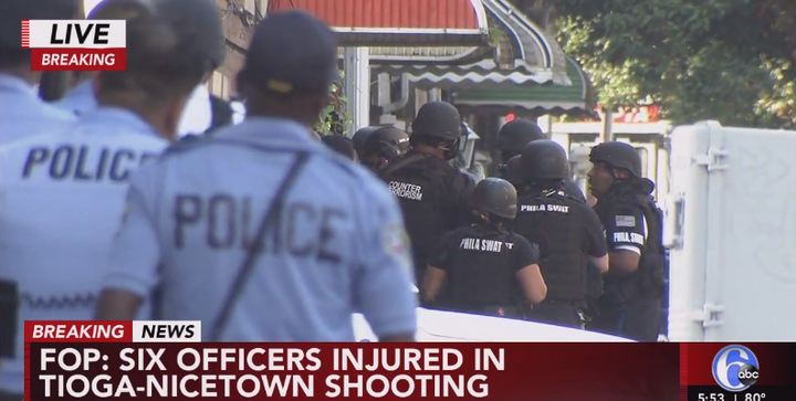 Philadelphia officers outside a home where a standoff is under way. Six officers have been shot. The wounds are reportedly non-life threatening. (Photo: ABC 6 Screen Shot from Live Coverage)  -