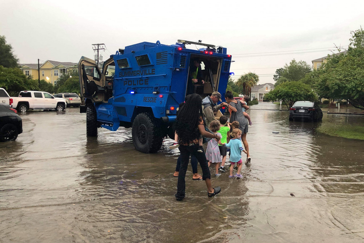 Officers with the Summerville (SC) Police Department saw that there was an imminent danger for kids at a local daycare facility attempting to get to their parents through street flooded with rainwater.  - Image courtesy ofSummerville (SC) Police Department / Facebook.