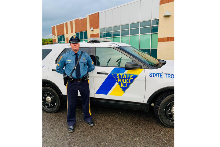 New Jersey State Trooper Charles Travis was near a resort swimming pool when he heard someone calling for help. He then performed life-saving CPR on a 7-year-old girl. 