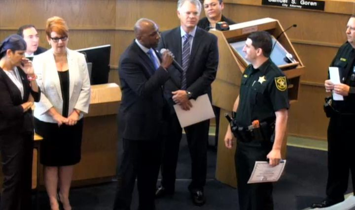 Tamarac, FL, city commissioner Mike Gelin, berates Deputy Joshua Gallardo during a 'Deputy of the Year' ceremony. (Photo: Tamara City Commission)