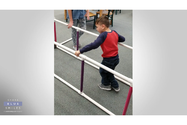 Officer Brad Brad Gagon of the Arvada (CO) Police Department built an 8-foot-long strength trainer to help a boy with cerebral palsy practice walking.  - Photo: CentralSquare screenshot