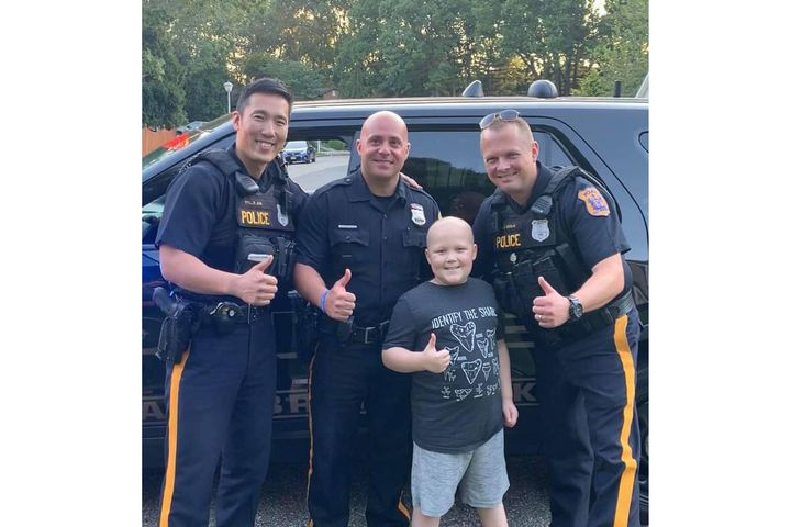 Officers with the East Brunswick (NJ) Police Department visited with a nine-year-old boy battling a rare form of cancer over the weekend.  - Image courtesy ofEast BrunswickPolice Department / Facebook.