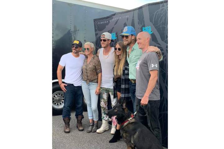 The country music duo Florida Georgia Line has donated a K-9 to the Indianapolis Police Department, the agency said on social media.  - Image courtesy of Indianapolis Police Department / Facebook.