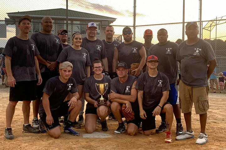 Deputies with the Scotland County (NC) Sheriff's Office faced off against the Laurinburg Police Department for the first ever 'Swinging for a Cure' softball game, aimed at raising money for cancer research.The police department came home with the inaugural trophy, plating 22 runs to the Sheriff's Office seven.  - Image courtesy ofLaurinburg Police Department / Facebook.