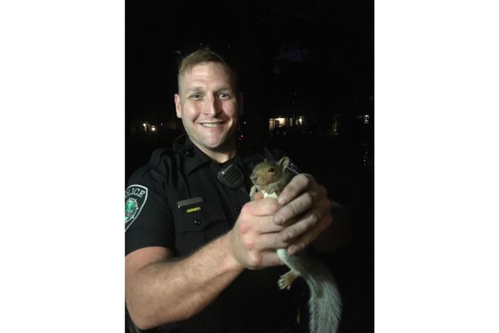 An officer with the Newport News (VA) Police Department responded to an unusual home invasion call on Tuesday as a couple reported to the non-emergency number that a squirrel was trapped in a fireplace.  - Image courtesy of Newport News PD / Facebook.