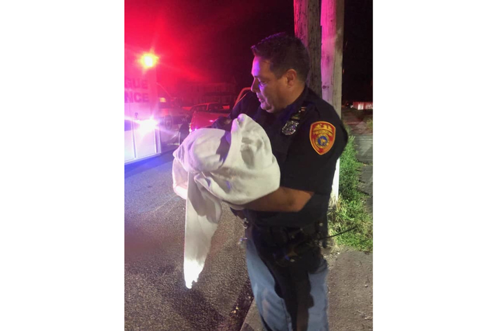 Officer Robert Burgos assisted as Edith Punin gave birth to a baby girl, Kayla Maritza.