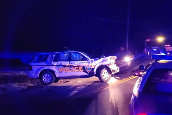 A lieutenant with the Middlesboro (KY) Police Department was involved in a rollover accident when he swerved to avoid striking a bicyclist who suddenly darted out in front of him while engaged in a vehicle pursuit on Tuesday.  - Image courtesy of the WRIL Radio / Facebook.