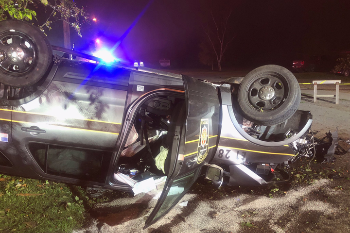 A burglary suspect who led Pennsylvania Troopers on a vehicle pursuit in Erie County over the weekend rammed at least one patrol vehicle, completely upending the SUV and causing injuries to the troopers inside.