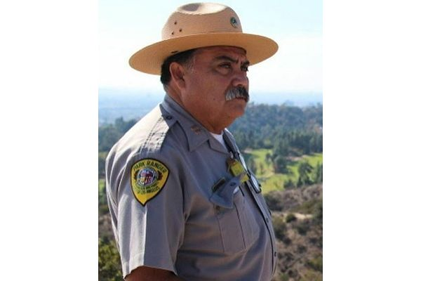 Captain Albert Torres with the Los Angeles Department of Recreation and Parks suffered a fatal heart attack after a 14-hour shift of patrolling parks and remote areas in the evacuation zone where wildfire had just destroyed more than 20 homes and prompted mandatory evacuations of 100,000 residents.