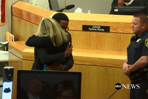 In an extraordinary act offaith in God, the younger brother of Botham Jean—who was reportedly shot and killed by an off-duty Dallas police officer as he sat in his apartment while sitting on his couch eating ice cream—took to the witness stand during the sentencing hearing to forgive that former officer and urge her to give her life to Christ.  - Screen grab of courtroom video.