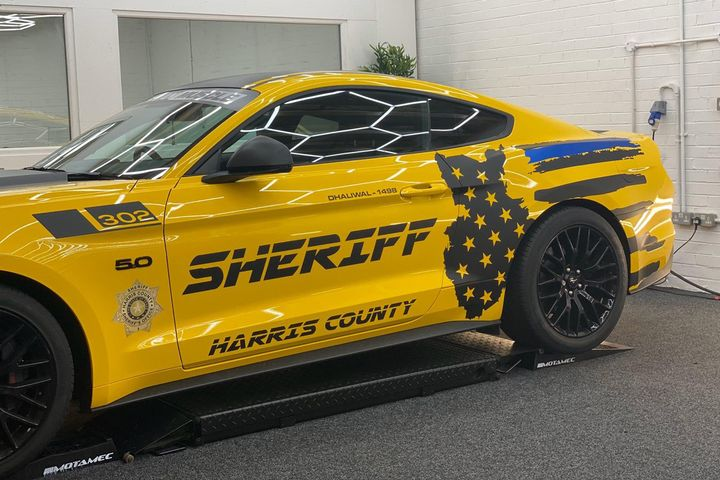 A man from the United Kingdom is paying tribute to the service of Harris County (TX) Deputy Sandeep Dhaliwal with a specially painted sports car. The car's owner—Raj Panesar—intends to display the car at Sikh events.  - Image courtesy of theHarris County Sheriff's Office / Twitter.