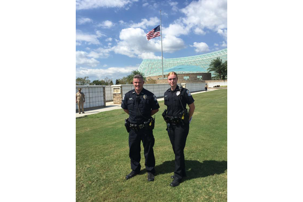 Two SPD officers joined the community at the Sarasota National Cemetery as 12 Veterans were laid to rest after their remains were unclaimed.  - Image courtesy of Sarasota PD / Facebook.