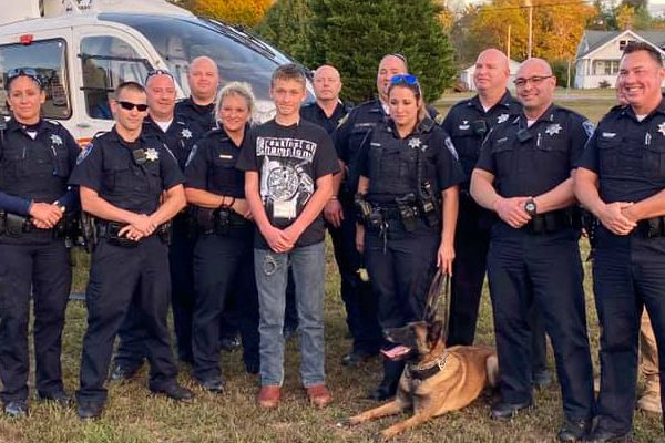 Officers from the White Pine Police Department, Dandridge Police Department, Jefferson County Sheriff's Department, Tennessee Highway Patrol, Tennessee Constables Association, and Cocke County Sheriff's Department surprised 14-year-old Caleb Sutton by showing up to his party, bringing with them a K-9 team and even a life-flight helicopter. - Image courtesy of White Pine Police Department / Facebook.