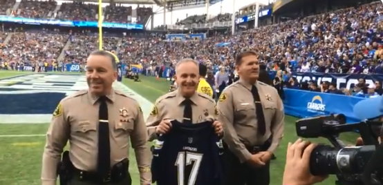 Screen grab of video showing reserve deputies with the Los Angeles County Sheriff's Department being honored prior to the contest between the Los Angeles Chargers and the Cincinnati Bengals of the NFL.  - Photo: KTLA screenshot