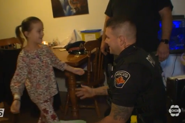 Constable Sean Connelly saved the life of 7-year-old Tiannah when she had a heart attack. - Photo: CHCH screenshot