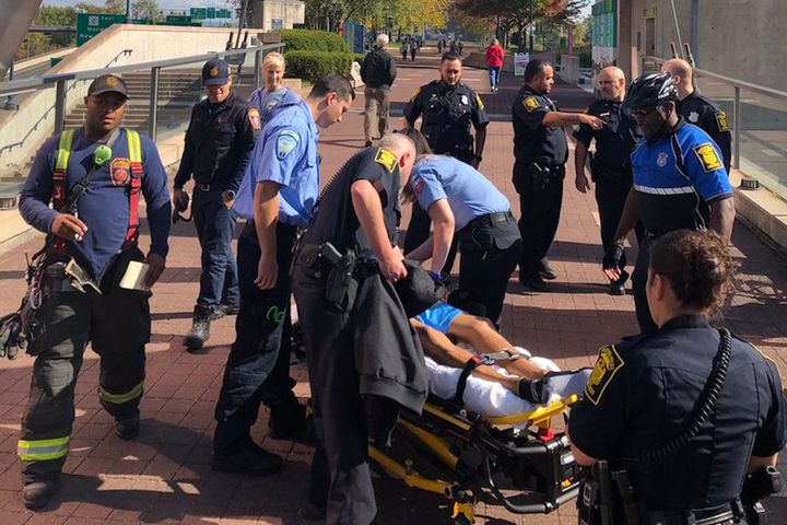 Officer Jimmy Barrett, to the right in bicycle uniform, grabbed a suicidal subject as he was attempting to jump off a ledge to the busy street below.