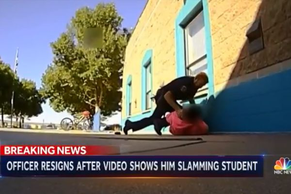 A school resource officer with the Farmington (NM) Police Department has tendered his resignation after video surfaced of him shoving an 11-year-old girl into a wall and then restraining her on the ground. - Screen grab of news report from NBC News.