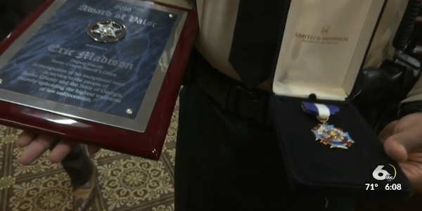 Georgia's Governor Brian Kemp presented Burke County Deputy Eric Madison with the Medal of...