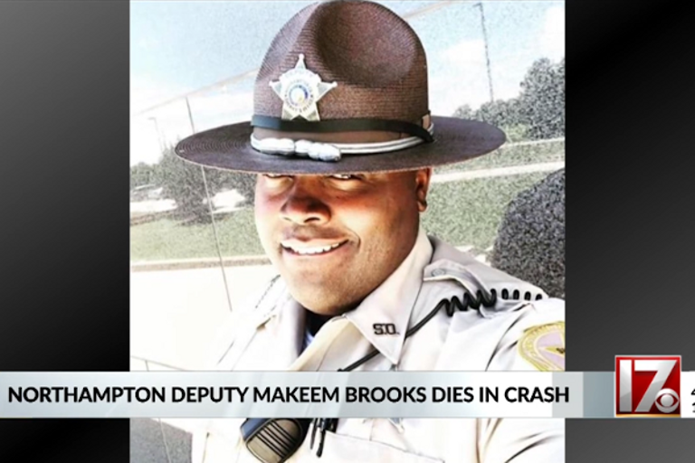 Deputy Makeem Brooks was reportedly traveling in an unmarked car with blue lights flashing when...