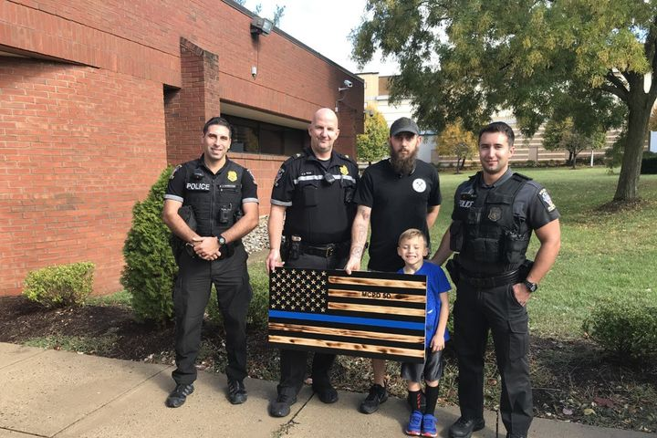 James Sheltonrecently made by hand a wooden representation of the Thin Blue Line Flag and dropped it off at the Montgomery County (MD) Police Department as a gift on National First Responders Day. - Image courtesy ofMontgomery County Police Department / Twitter.