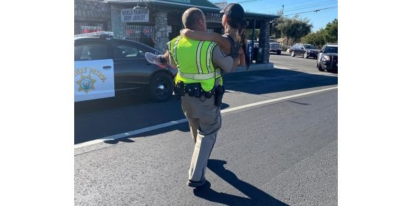 An officer with the California Highway Patrol came to the aid of a runner who suffered a stress...