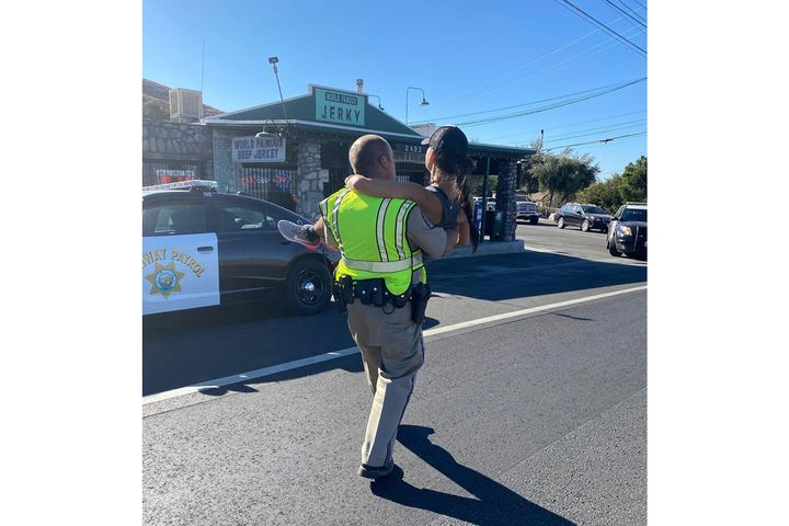 An officer with the California Highway Patrol came to the aid of a runner who suffered a stress fracture in her leg during a marathon / half-marathon event over the weekend in the forested area of Big Bear in the mountains just east of Los Angeles. - Image courtesy of CHP / Facebook.