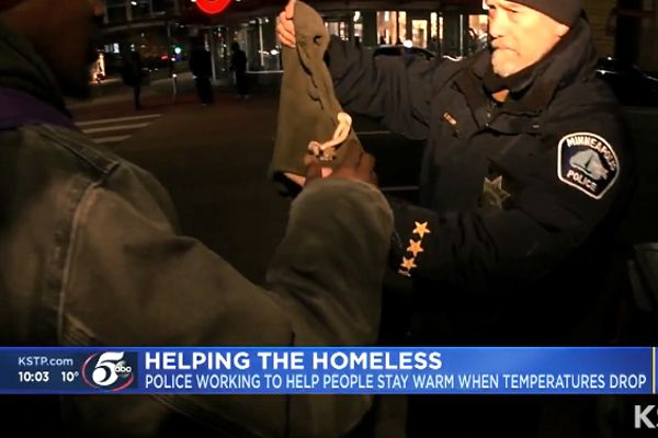 A handful of officers with the Minneapolis Police Department are now equipped with warm hats and gloves to give to homeless individuals at serious risk of exposure during the approaching winter months. - Screen grab of news report by ABC News.