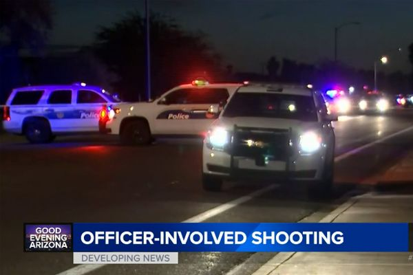 "Two officers with the Phoenix Police Department were injured during a standoff with a man who had ""pistol whipped"" a 69-year-old woman and threatened other residents in a home on Sunday night. - Screen grab of news report."