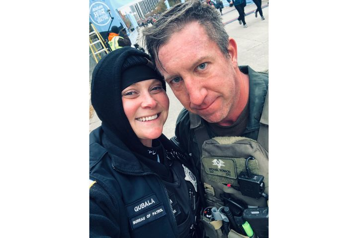 Sergeant Mike Nowacki performed CPR on an unresponsive woman near the finish line of the annual Allstate Hot Chocolate Run. Then he proposed marriage to his girlfriend, Officer Erin Gubala.  - Image courtesy of Chicago Police Department / Facebook.