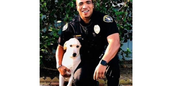 Officer Andre Thomas was still mourning the loss of his beloved pet Melakai—a Yellow...