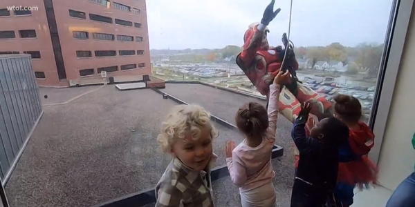 Toledo SWAT Officers Dress as Superheroes, Rappel Down Children's Hospital to Entertain Kids on...